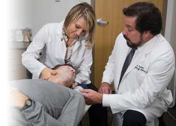 Photo of intern adjusting patient with clinician supervising