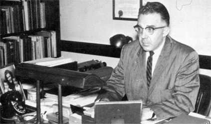 Photo of Dr. Janse at desk