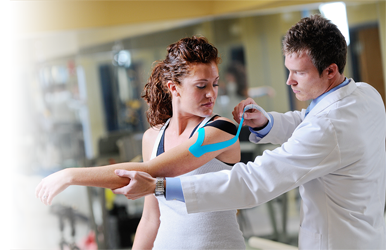 Photo of intern taping patient's shoulder