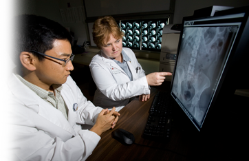 Photo of interns reviewing image