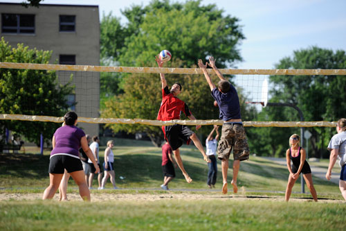 Photo of students playing volleyball on campus