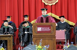 Photo of President Stiefel addressing graduates