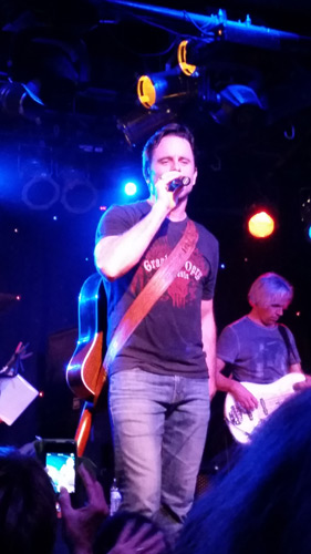 Photo of Chip Esten singing at concert
