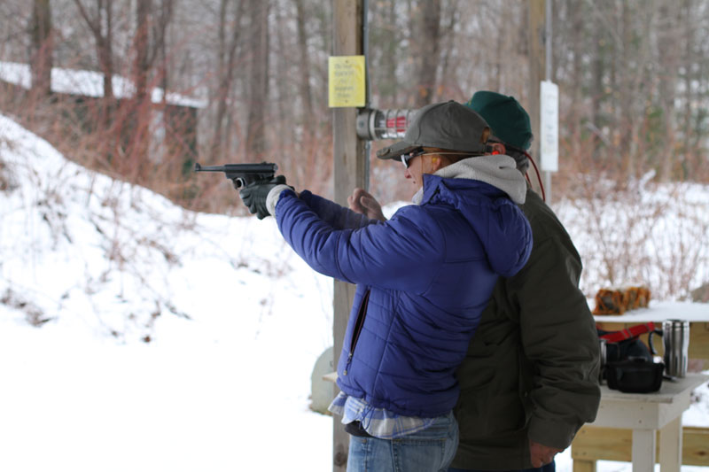 Photo of shooting a pistol at firing range