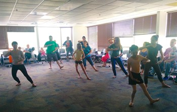 local families participating in dance class