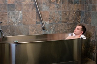 patient immersed in Peat Immersion Baths