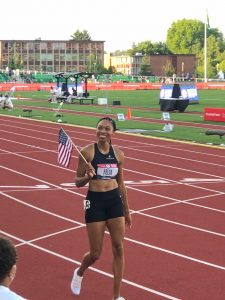 olympic trials athlete holding american flag