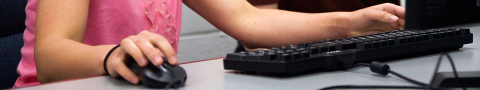 student using mouse and keyboard